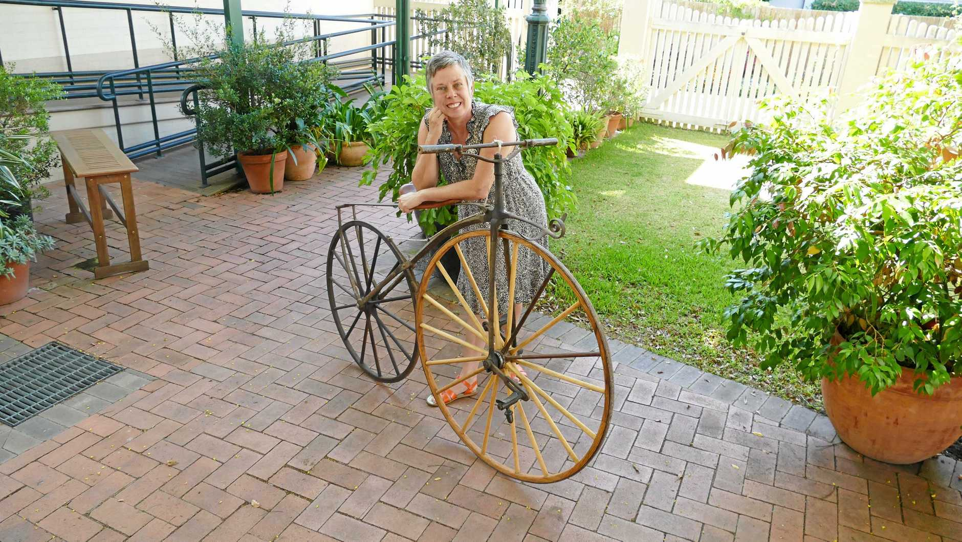 RARE TREASURE: One of the producers of the Bike Town exhibition, Sammy Lovejoy, with a circa 1862 velocipede a Sydney collector has donated for the exhibition.
