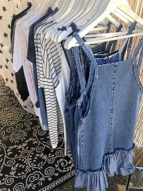 Some of the Ritch n Steele designs at Eumundi Markets, including the denim pinafore dress (front).