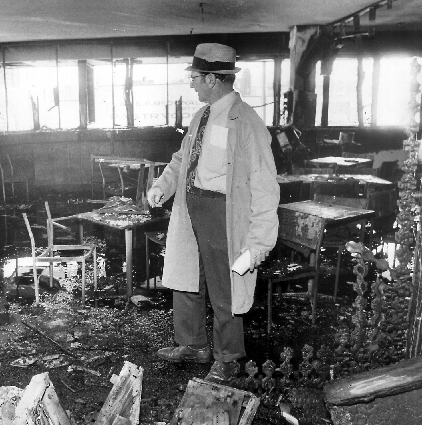 Inspector L Bardwell of CIB Forensic Science inside bombed Whiskey Au Go Go nightclub, Brisbane in 1973.