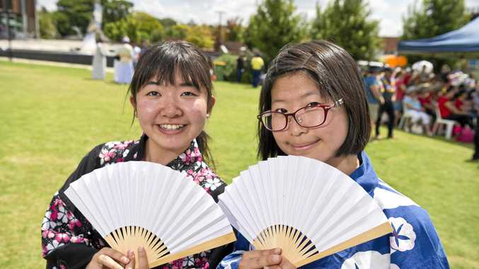HARMONIOUS CELEBRATION: Centenary Heights State High School Japanese exchange students Moe Nakaoka (left) and Kurumi Omatsu display traditional Japanese culture in the Civic Square.