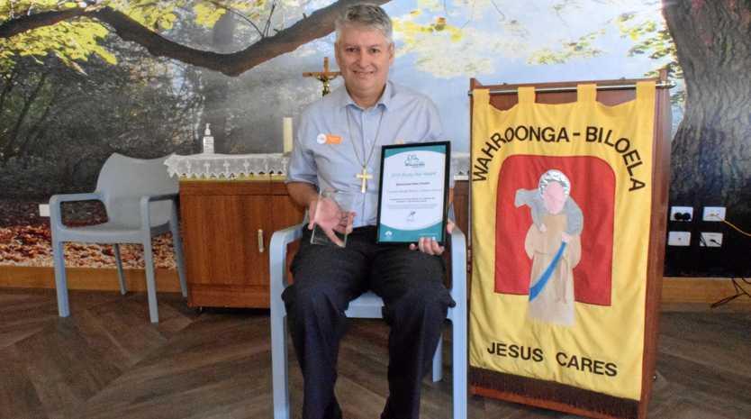 HUMBLED: Biloela Lutheran Church chaplain George Rankin with his Rising Star Award for his work at Wahroonga.