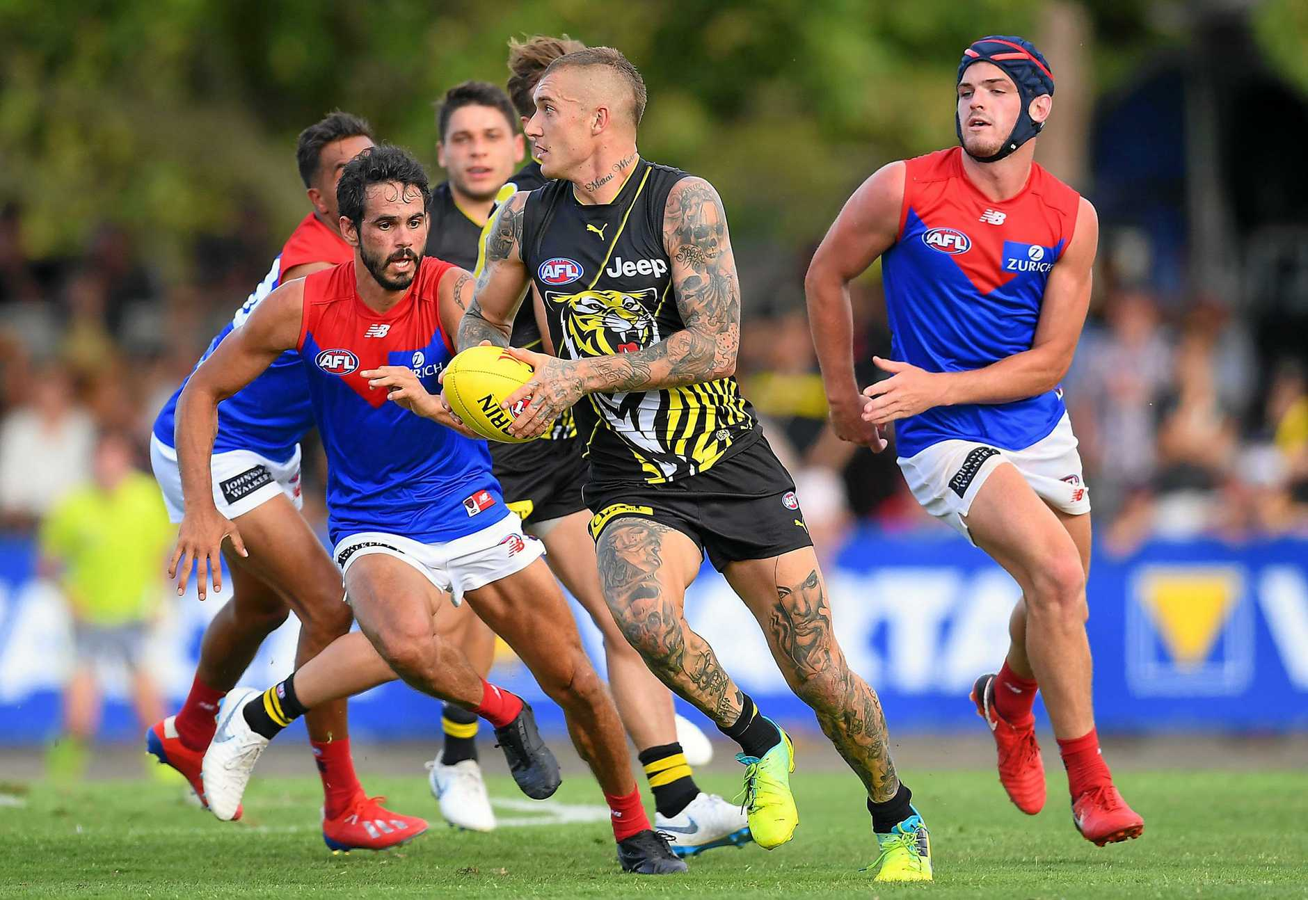 MELBOURNE, AUSTRALIA - MARCH 03: Dustin Martin of the Tigers breaks free from the centre during the 2019 JLT Community Series AFL match between the Richmond Tigers and the Melbourne Demons at Deakin Reserve on March 03, 2019 in Melbourne, Australia. (Photo by Quinn Rooney/Getty Images)