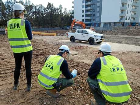 The EPA team take samples at a construction site as part of ongoing investigations into illegal dumping in Sydney.