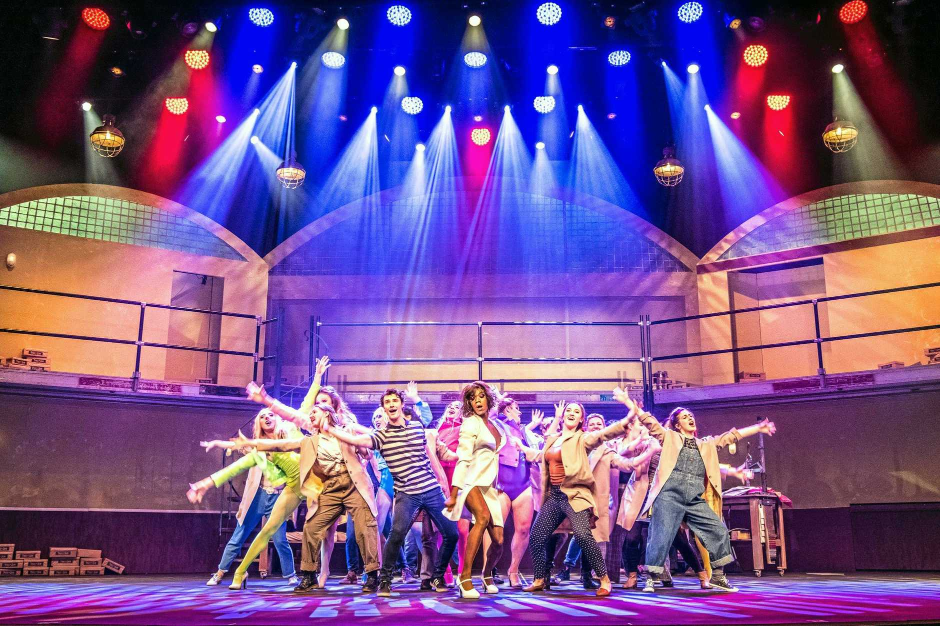 FUN AND FLAIR: The cast of the Empire Theatre's Kinky Boots with stars (centre) Sean Johnston as Charlie, and Timothy Springs as Lola.