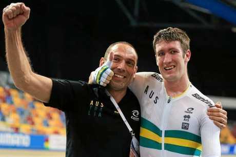 David Nicholas OAM (right) celebrates his world title win with coach Paul Formosa (left).