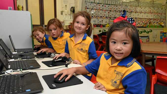 MY FIRST YEAR: Prep 1L students at Maryborough Central State School Jessie Burgess, Tori-Lee Baldwin, Gracie Shaw and Victoria De Guzman on the class computers.