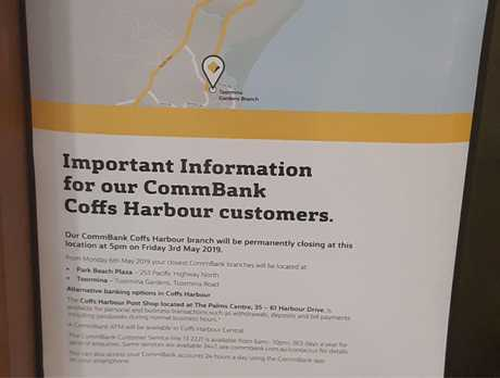 The sign informing customers that the CBA branch in Coffs Central will close.