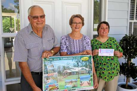 Past winners Allan, Adelyn and their daughter Melissa Webb unveil the Endeavour Foundation's $1.3 million prize home in Montville.