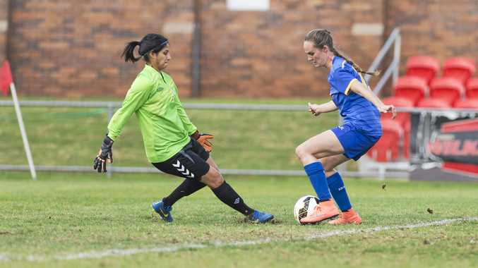 CALM ON THE BALL: Abbey Lloyd beats The Gap keeper Noran Abaza before going on to score. The former South West Queensland Thunder striker will face her old club when she lines up for Capalaba tomorrow.