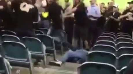 One man lies on the ground after copping several blows to the head and upper body.