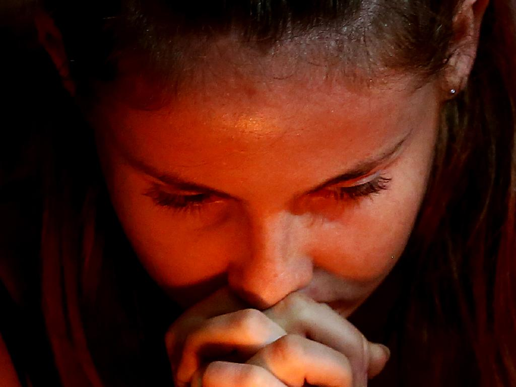 A young girl prays during the vigil in Dunedin, New Zealand. Picture: Dianne Manson/Getty Images