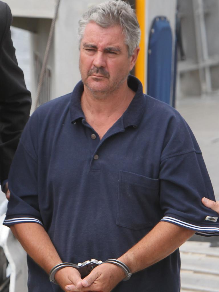 Steven Mark John Fennell in police custody in 2013