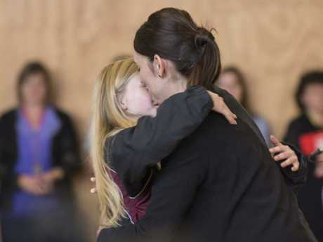 New Zealand Prime Minister Jacinda Ardern hugs a student at Cashmere High School. Picture: David Alexander/AAP