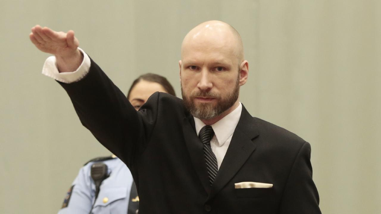 Anders Behring Breivik raises his right hand in court. Picture: Lise Aaserud/NTB Scanpix