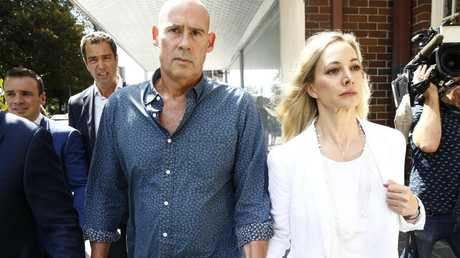 The parents of swim coach Kyle Daniels leave Manly Court after their son was granted Bail.  Picture: John Appleyard