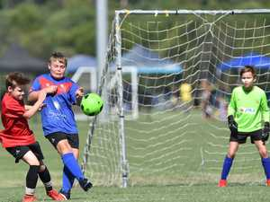Junior Soccer. Caloundra's Nate Keough (left).