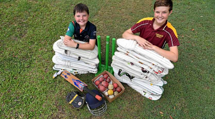 BATS OFF: Ashton and Toby Lamond with some of the gear that will be donated to a charity in India.