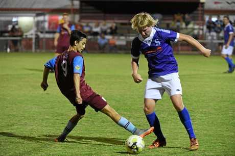 Brothers Aston Villa's James Stromquist battles Sunbury's Tyson Bedford for the ball.