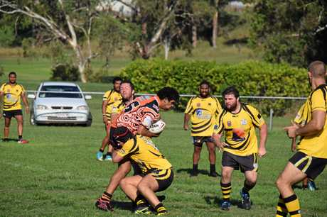STUNG: Hornets forward is hit by strong Wondai defence.