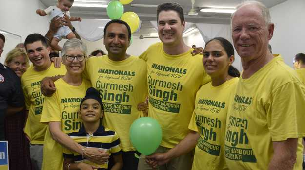 Nationals candidate Gurmesh Singh celebrates the campaign with retiring Member for Coffs Harbour Andrew Fraser and his supporters on election night.