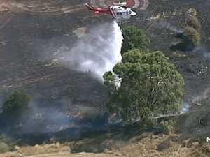 Homes threatened in suspicious grassfire