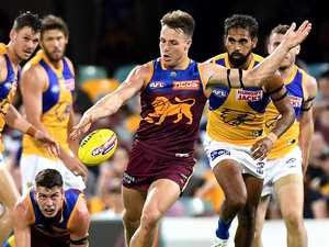 Lions hit ground running to cause AFL boilover