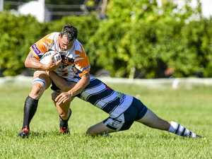 Wallaby's Jason Batchelor is tackled by Gladstone
