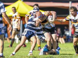 Wallaby's Lochlan Winston is tackled by Gladstone