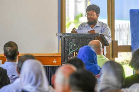 Islamic Society of Gladstone president Mohammed Uddin speaks at a morning of prayer for victims of the Christchurch terror attack. INSET: The crowd pauses for a moment of prayer including representatives from council, Government and police.