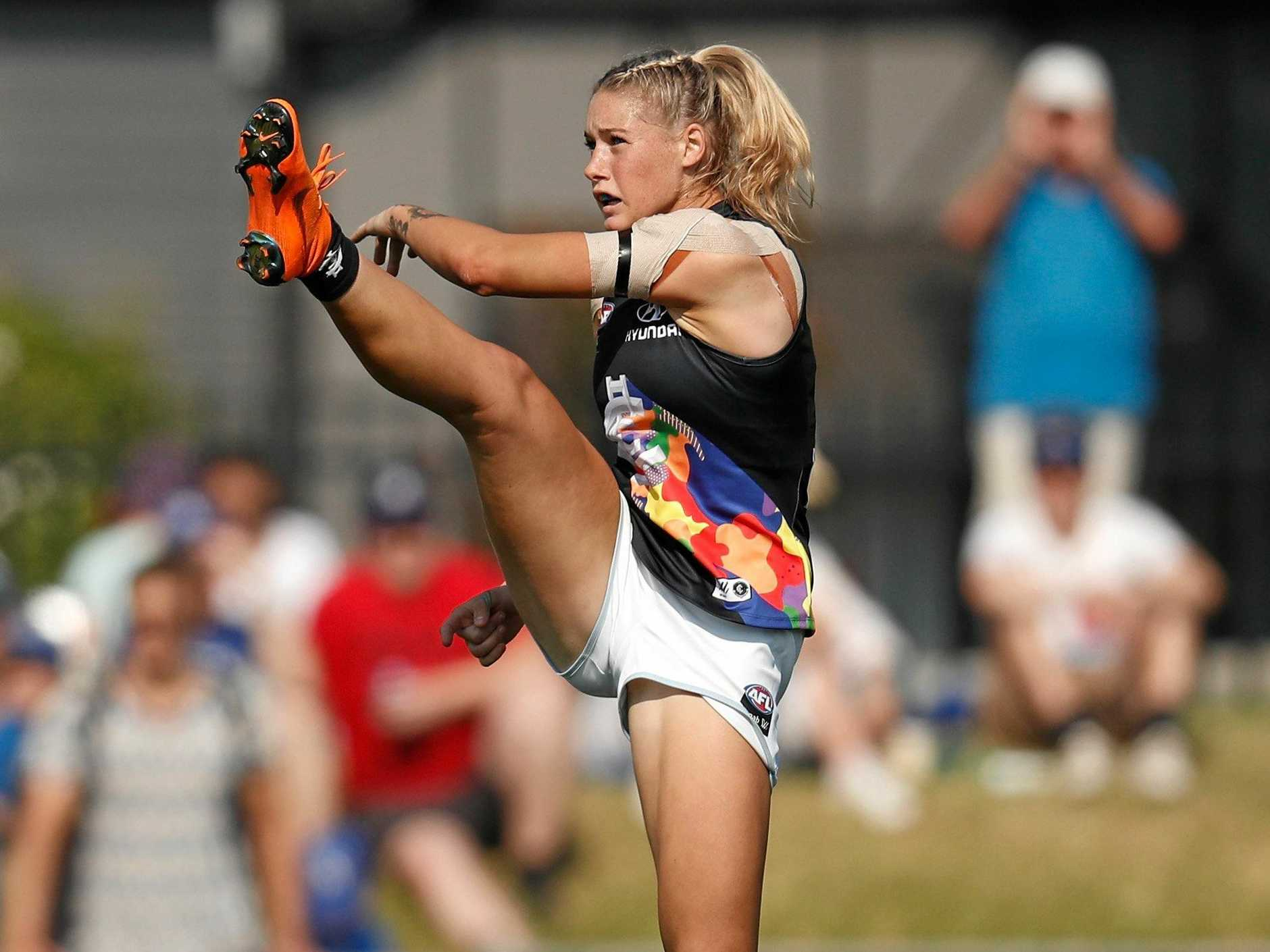 FLYING HIGH: Tayla Harris of the Carlton Blues kicks the ball. This image has quickly become one of the most iconic in Australian sporting history.