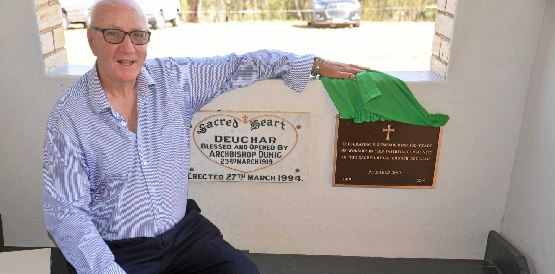 Fr Rod MacGinley unveils the plaque at the Sacred Heart Catholic Church, Deuchar, 100th anniversary celebrations on Saturday.