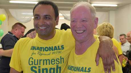 Retiring Member for Coffs Harbour Andrew Fraser hands over the baton to Nationals candidate Gurmesh Singh after 28 years in office. The new government will be sworn-in in May.