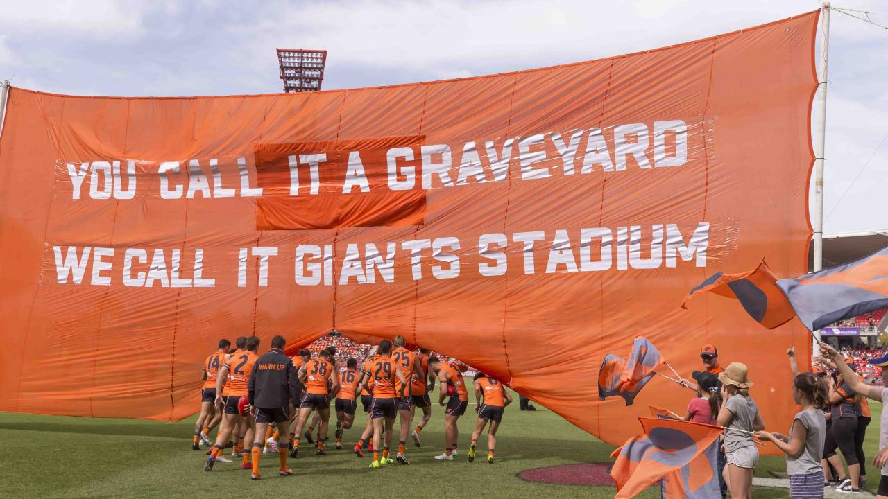 The Giants run through their banner before burying the Bombers. Pic: AAP