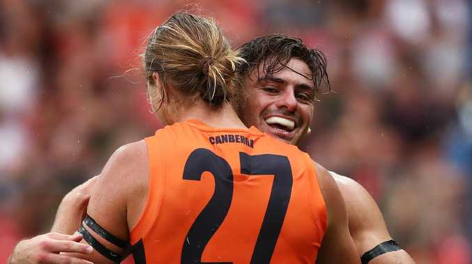 Giants Stephen Coniglio celebrates kicking a goal with Harry Himmelberg during AFL match between the GWS Giants and Essendon at Giants Stadium. Picture. Phil Hillyard