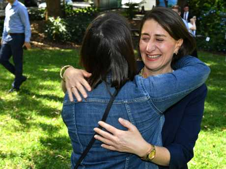 Ms Berejiklian hugs locals after her press conference in Willoughby on Sunday. Picture: AAP