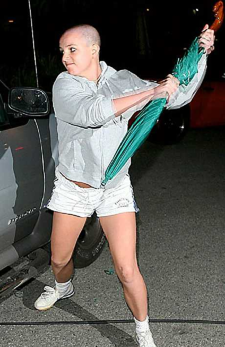 She unleashed on a paparazzi's car with an umbrella.