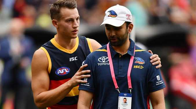 Tom Doedee of the Crows walks from the ground at half time after rupturing his ACL. Picture: Daniel Kalisz/Getty Images
