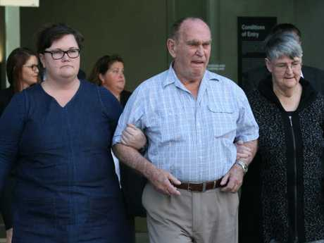 Barbara McCulkin's brother Graham Ogden (centre) leaves court after the sentencing of O'Dempsey and Dubois.