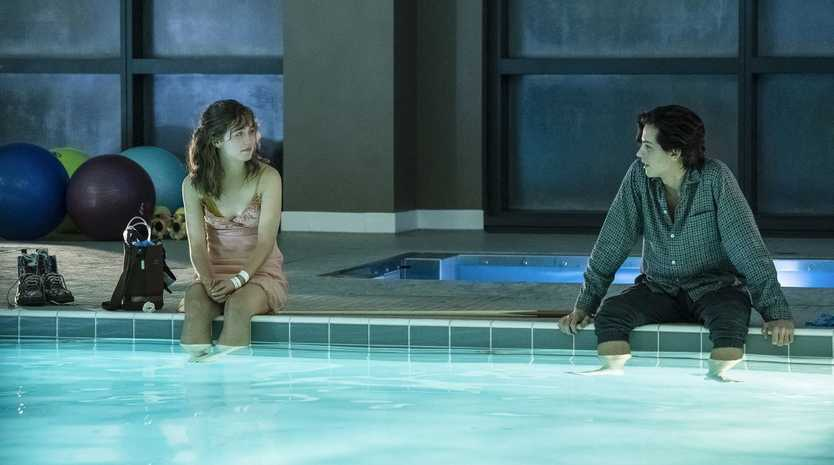Haley Lu Richardson and Cole Sprouse in a scene from Five Feet Apart.