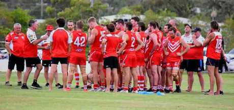 BIG YEAR: Yeppoon Swans coach Mark Wallin addresses his players during last weekend's pre-season trial game against the Hervey Bay Bombers.