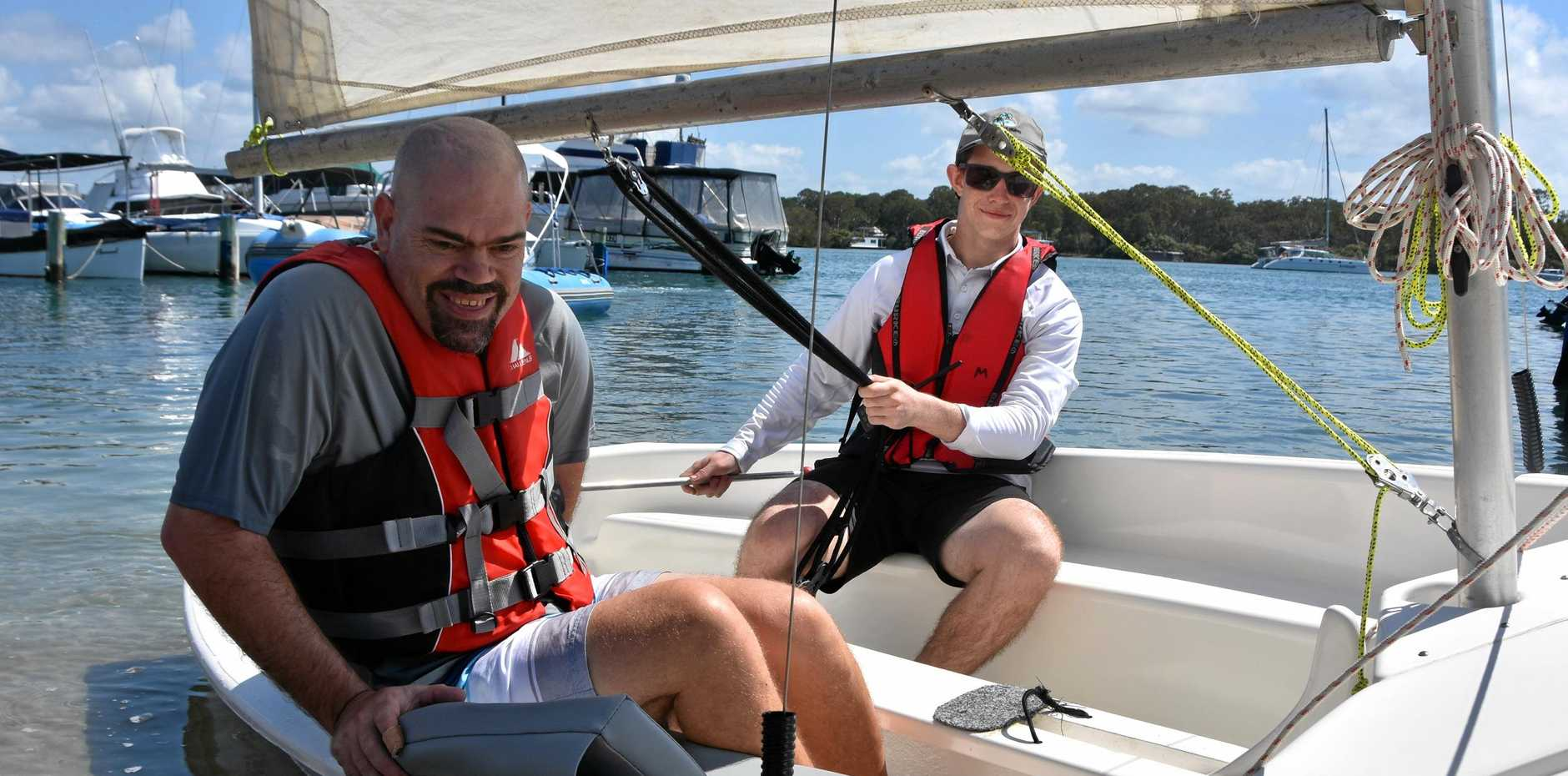 SMOOTH SAILING: Jason Wellington (left) enjoyed his first day back at Sailability from the comfort of newly designed seats.