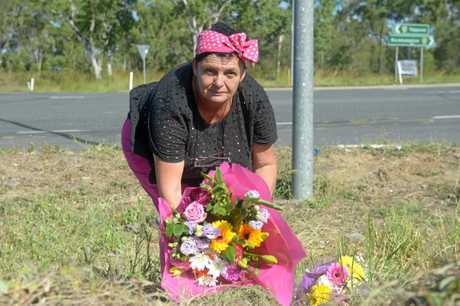 Local resident Peg Payne lays flowers on the intersection where Zara Pakleppa lost her life in a two car collision