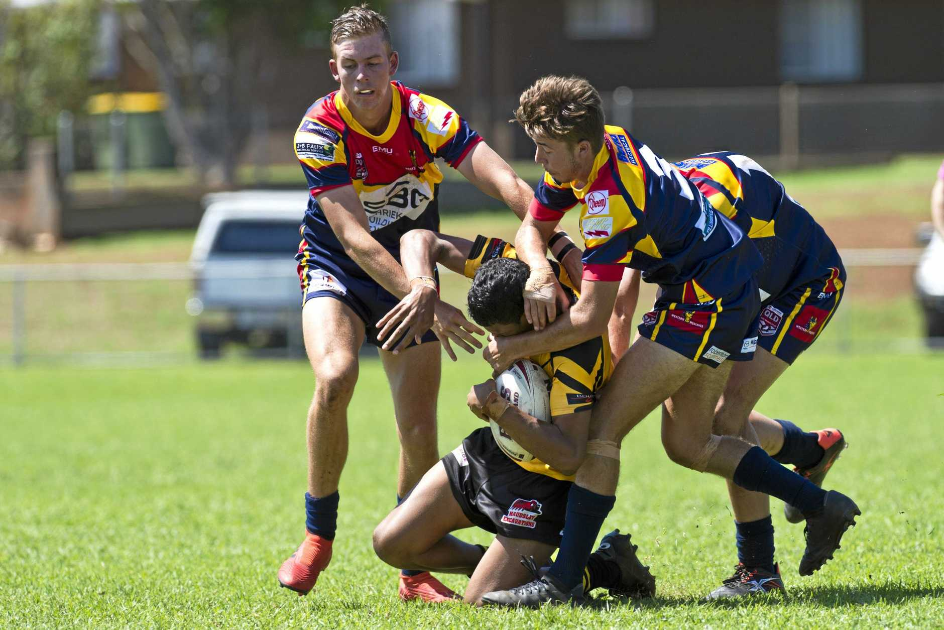 HARD HITTING: Jordan Lipp (left) and Oliver Moy bring down a Sunshine Coast Falcon during Sunday's Mal Meninga Cup game.