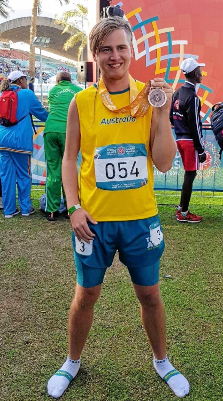 CHAMPION: Brady Rose with his bronze medal in the Special Olympics World Games in Abu Dhabi after competing.