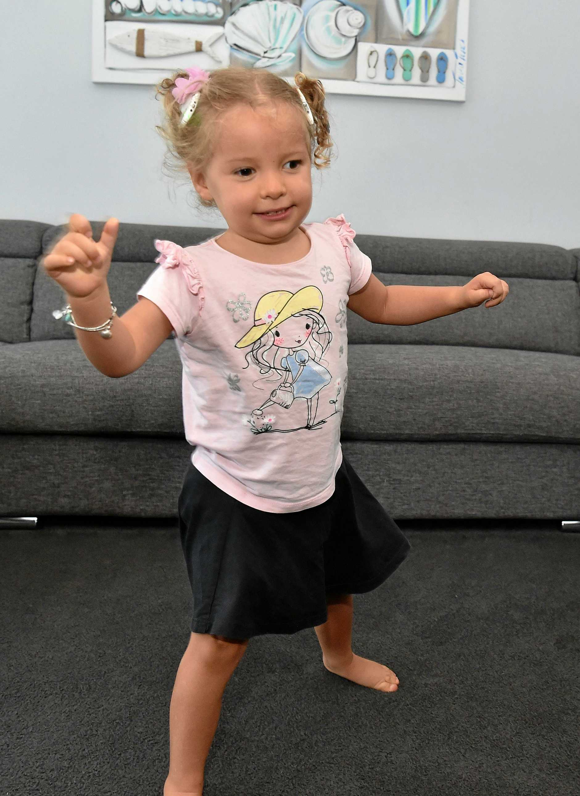 Three-year-old Keira has just taken her first steps. She was born with CMV and is deaf. Her parents were told she would never walk.