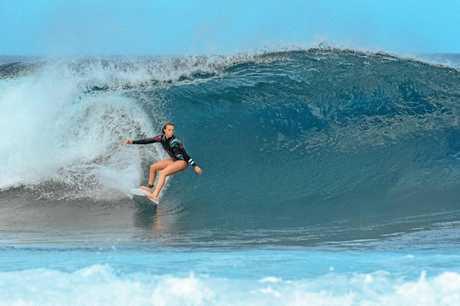 Noosa 13-year-old Amarnie Barber shredding a monster at Waimea Bay in Hawaii.