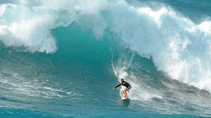 WUNDERKIND: Noosa 13-year-old Amarnie Barber shredding a monster at Waimea Bay in Hawaii.