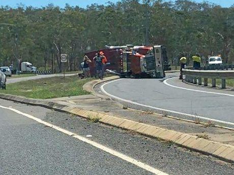 A semi-trailer has fallen on its side at the Gladstone-Benaraby Rd roundabout near Boyne Island.