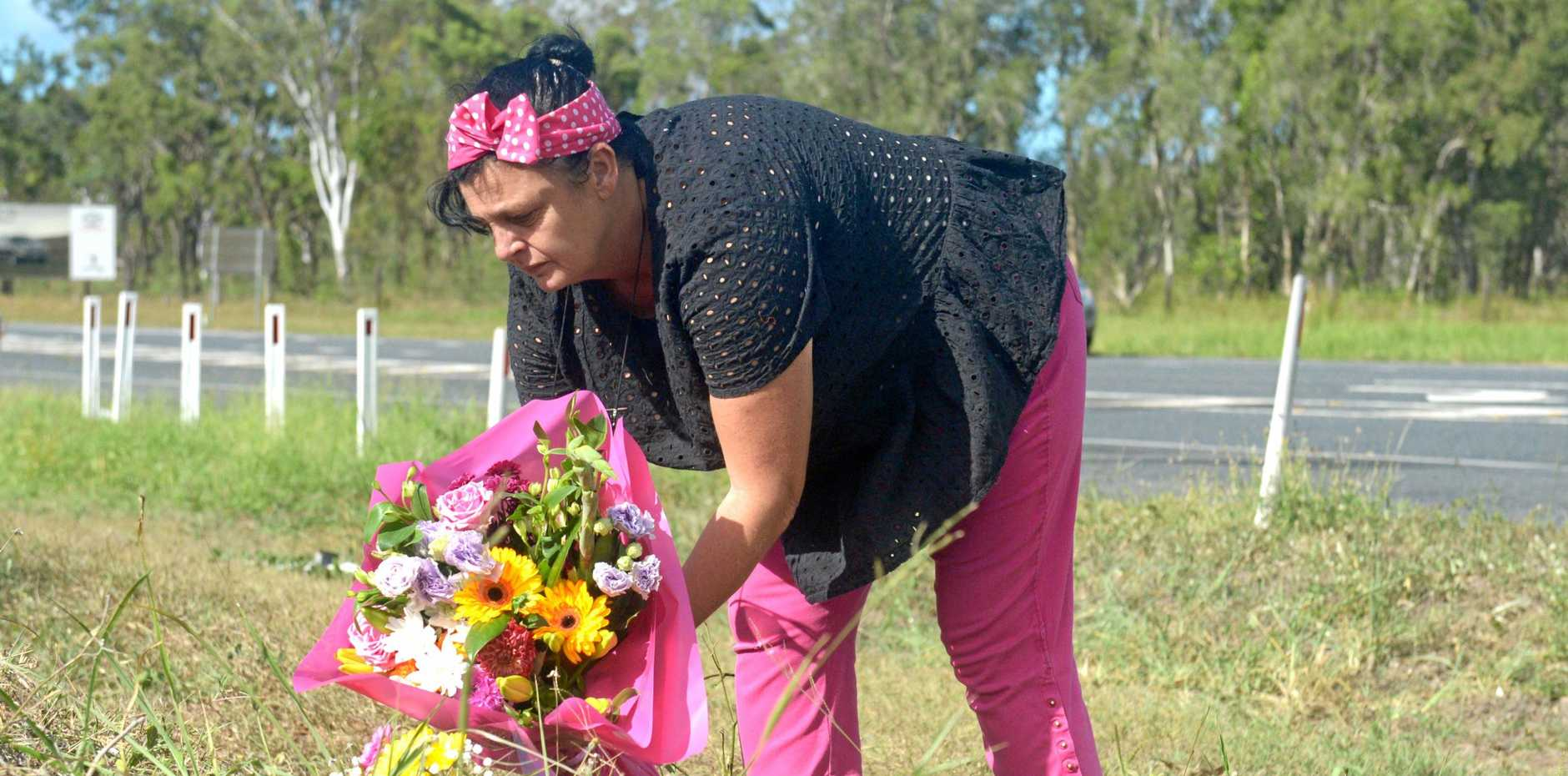 Local resident Ped Payne lays flowers on the intersection where Zara Pakleppa lost her life in a two car collision