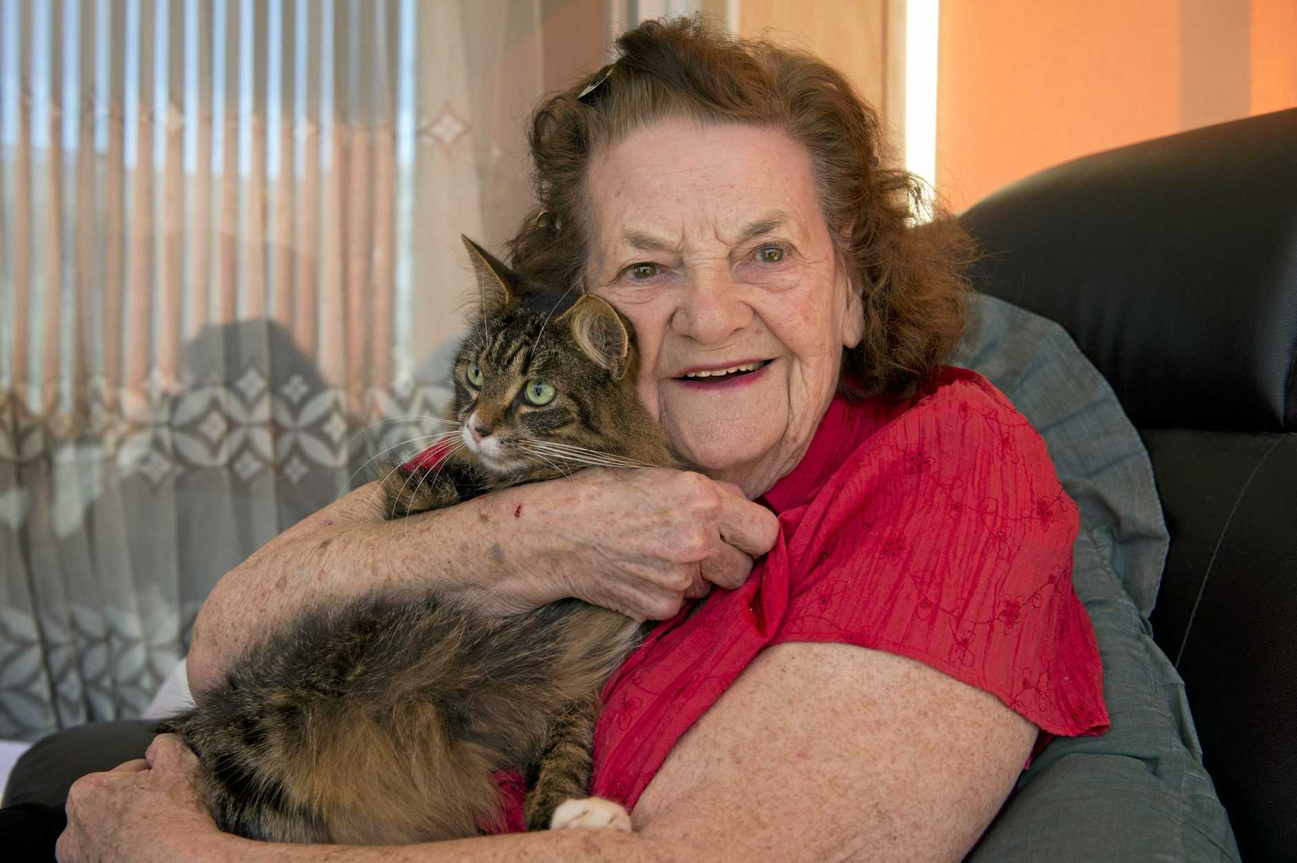 IN MEMORY: Avid reader and letter writer Joan Dunlop, with her cat Molly in 2014, has been remembered as a pragmatic woman with a love of community.